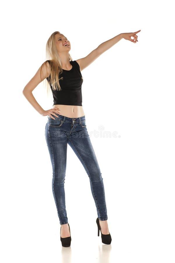 Blonde nas calças de brim fotos de stock royalty free