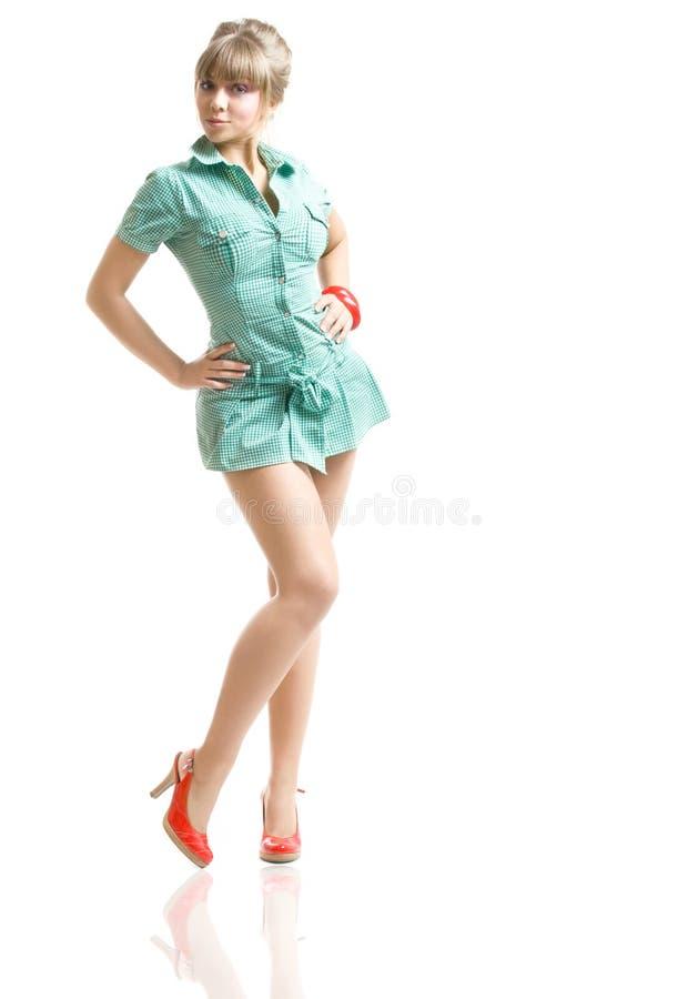 Blonde no vestido verde foto de stock royalty free