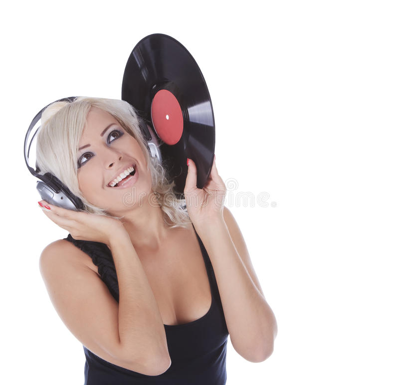 Blonde nos auscultadores com registro de vinil imagem de stock