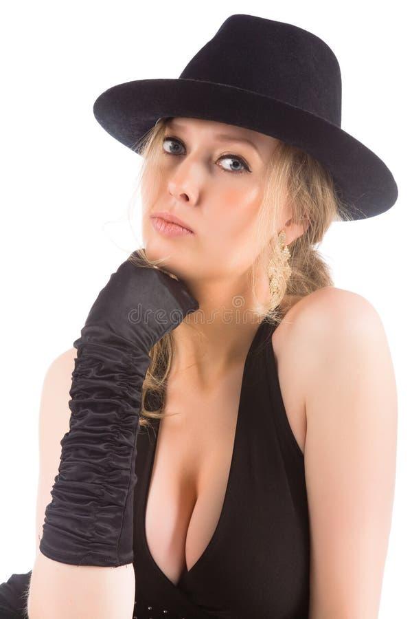 Blonde novo com chapéu negro imagem de stock royalty free