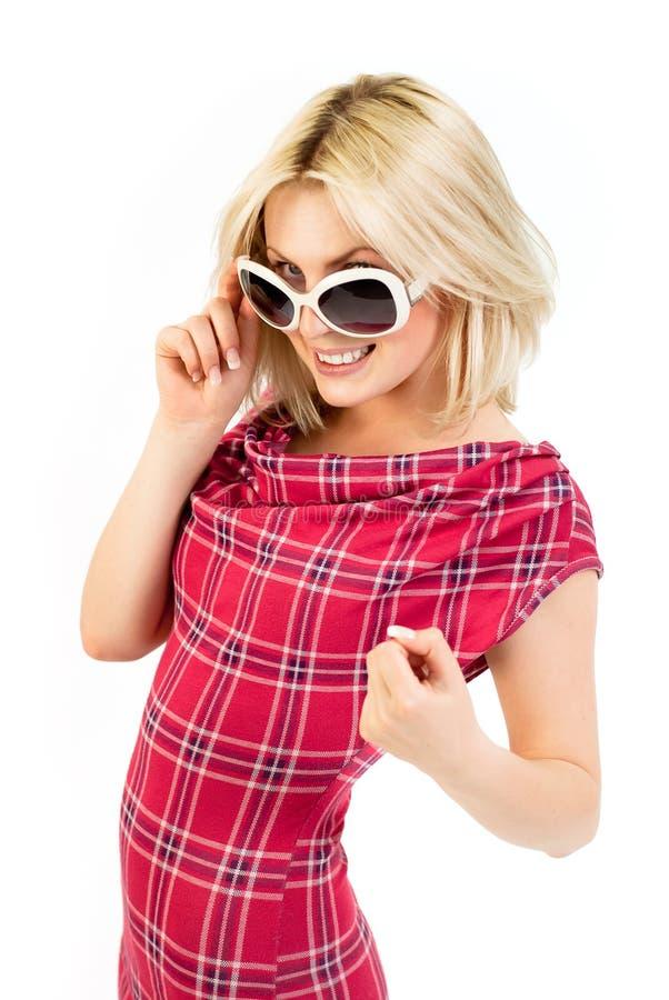 Blonde novo no vestido do tartan foto de stock