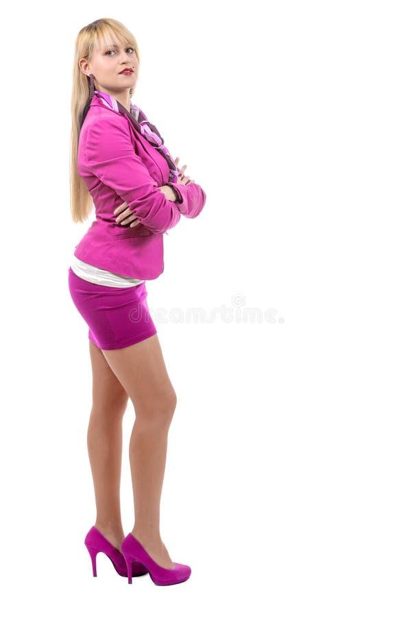 Blonde onderneemster met roze kostuum royalty-vrije stock foto's