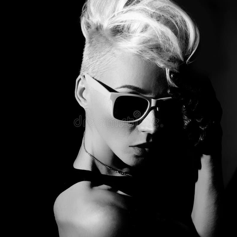 Blonde punk fashion style black and white photo. Glamorous blonde punk fashion style black and white photo stock photos