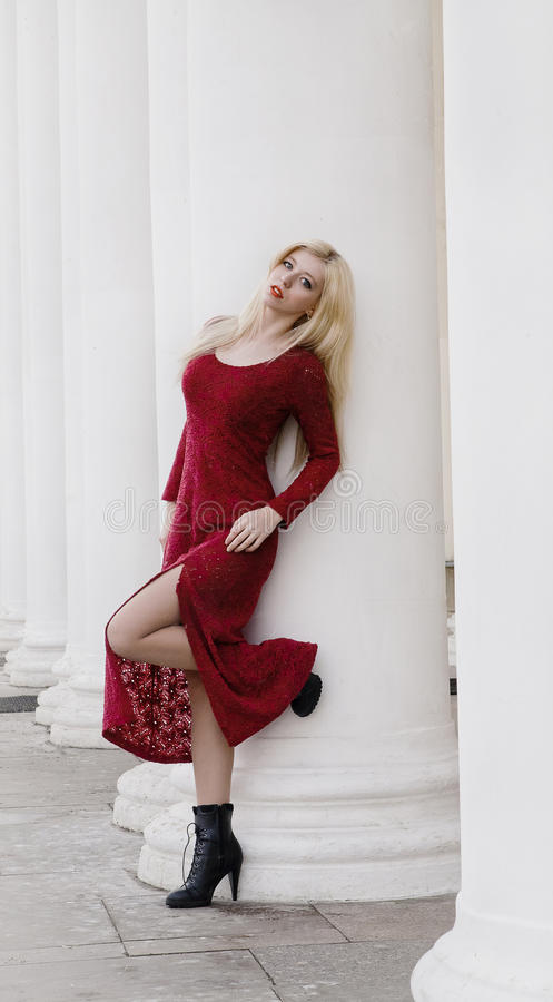 Blonde in red dress stock photo