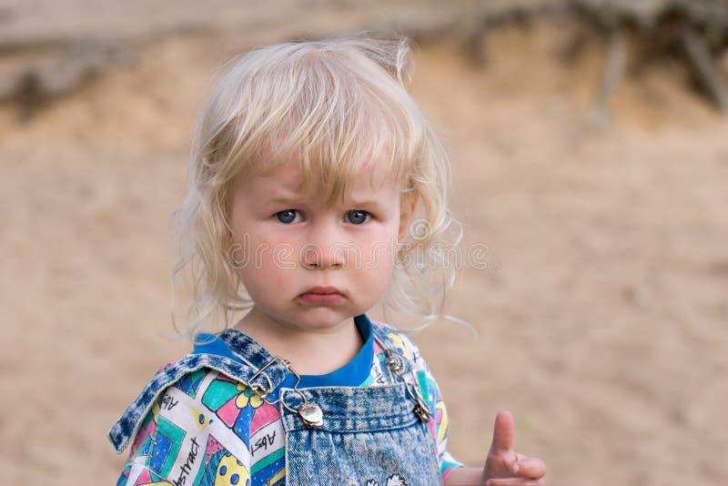 Blonde sad little girl royalty free stock photos