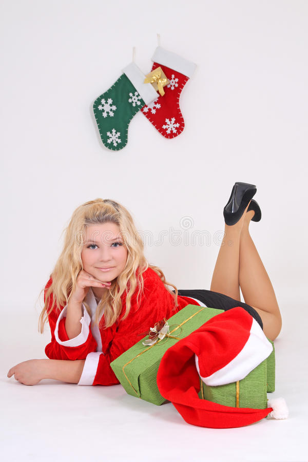 Download Blonde In Santa Costume With Gift Stock Photo - Image of green, attractive: 27356768