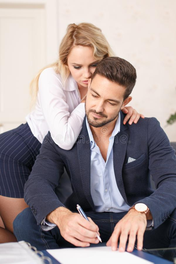 Free Blonde Secretary Lover Seducing Rich Boss In Office, Whispering, Mind Control Royalty Free Stock Images - 106268269