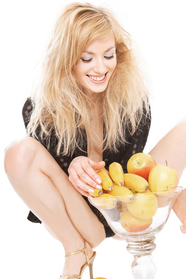 Blonde 'sexy' com frutas foto de stock royalty free