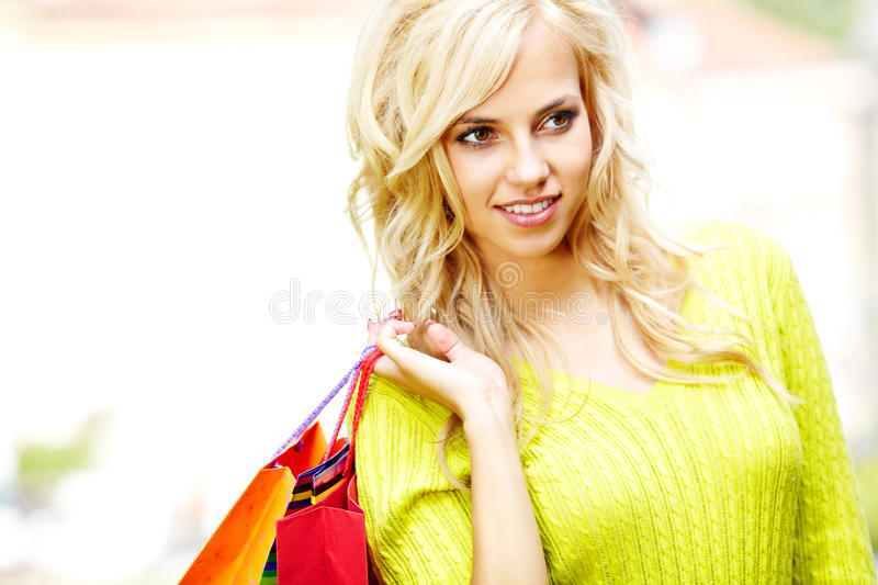 Blonde shopping woman with bags stock image