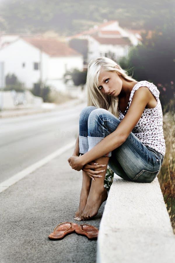 Download Blonde sitting stock photo. Image of pretty, asphalt, hike - 9431500