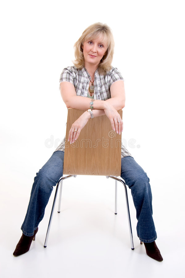 Blonde Sitting On Chair stock photos