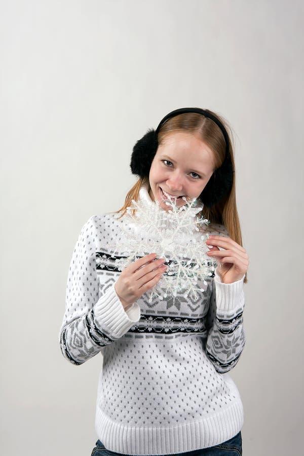 Blonde, snowflake and black fur headphones royalty free stock images