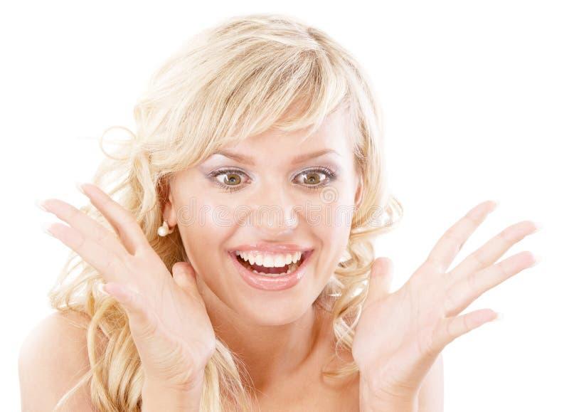 Blonde sonriente en la admiración alegre fotografía de archivo libre de regalías