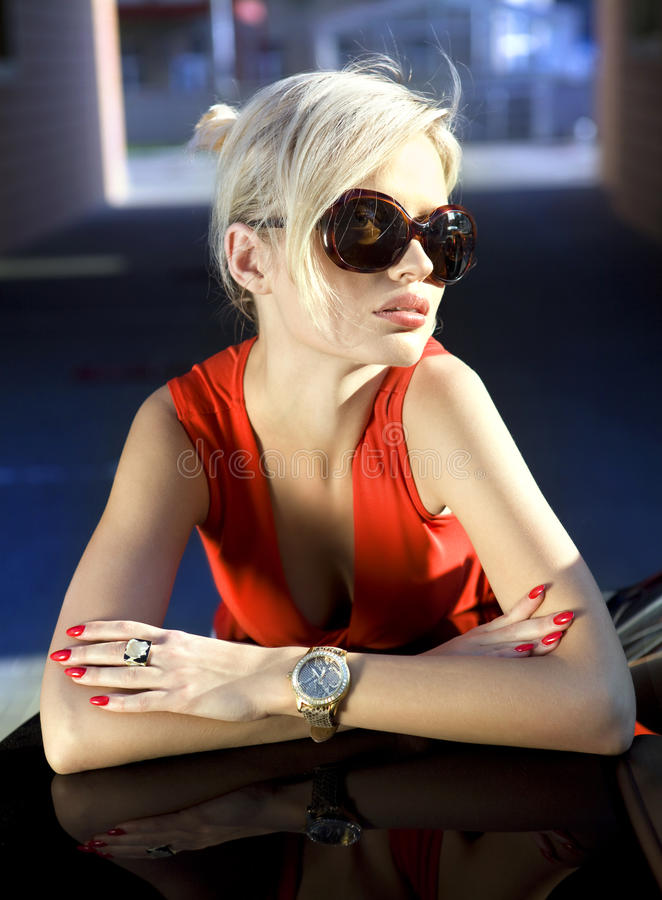 Blonde in sunglasses stock image