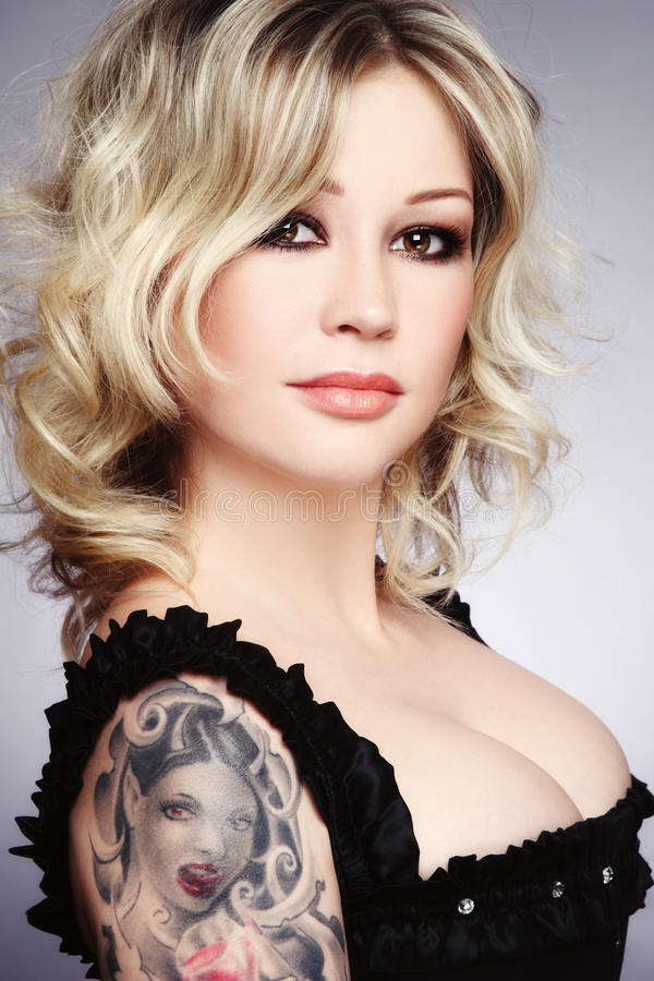 Download Blonde with tattoo stock photo. Image of hairstyle, curly - 16674954