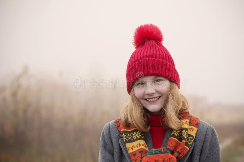 Blonde teenager girl in autumn field stock images