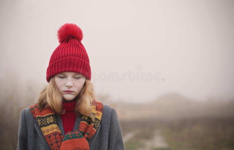 Blonde teenager girl in autumn field royalty free stock photo