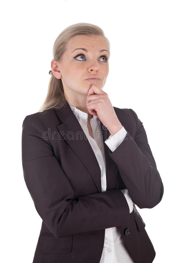 Blonde thinking business woman stock image