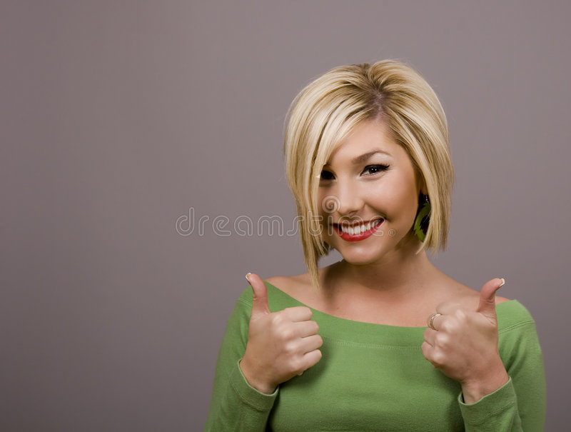 Blonde Thumbs Up stock image