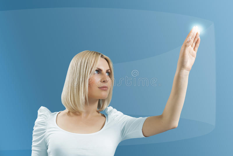 Blonde touching hi-tech - Interfaces royalty free stock photography