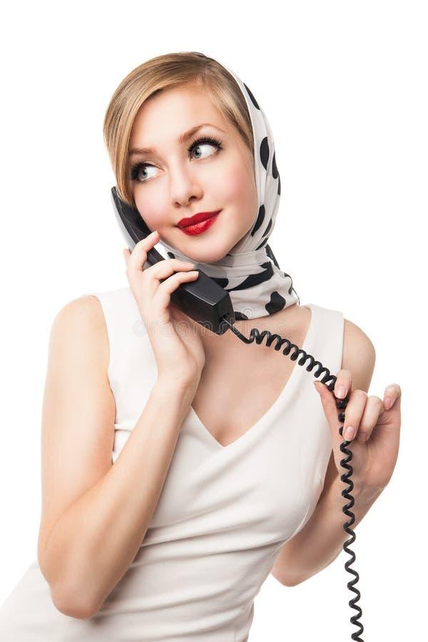 Blonde vrouw die op de telefoon spreken retro Geïsoleerde royalty-vrije stock foto's