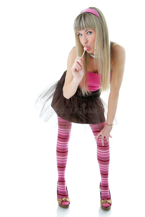 Blonde vrouw die suikergoed likt royalty-vrije stock foto