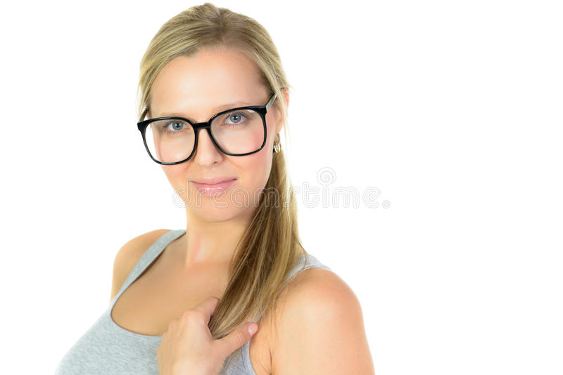 Blonde vrouw in glazenglimlachen royalty-vrije stock foto