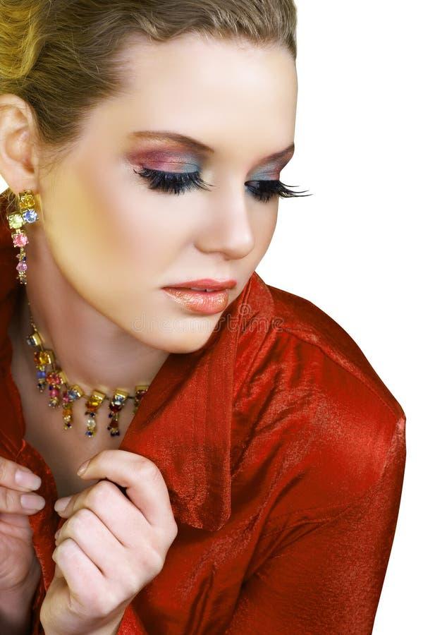 Blonde vrouw in rood royalty-vrije stock foto