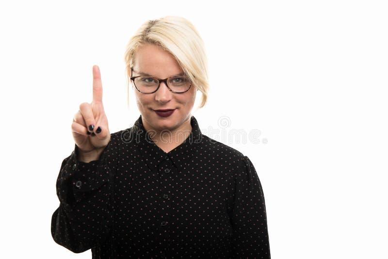 Blonde vrouwelijke leraar die glazen dragen die aantal met FI tonen royalty-vrije stock foto