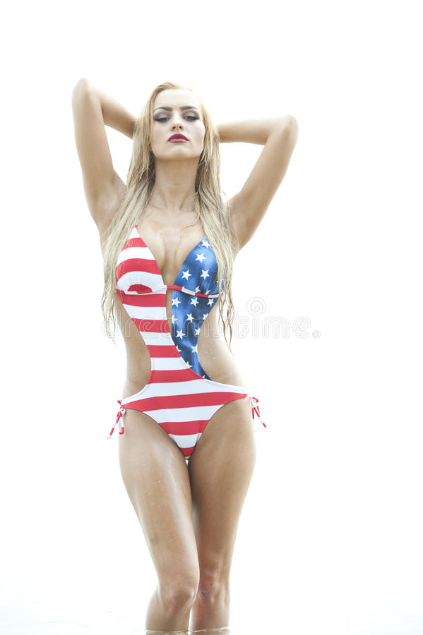 Blonde Wearing American Flag Swimsuit royalty free stock photography