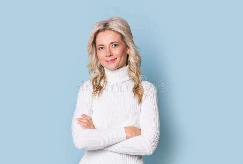Blonde woman adult attractive beautiful smiling portrait, cauasian and scandinavian girl on blue background stock photos