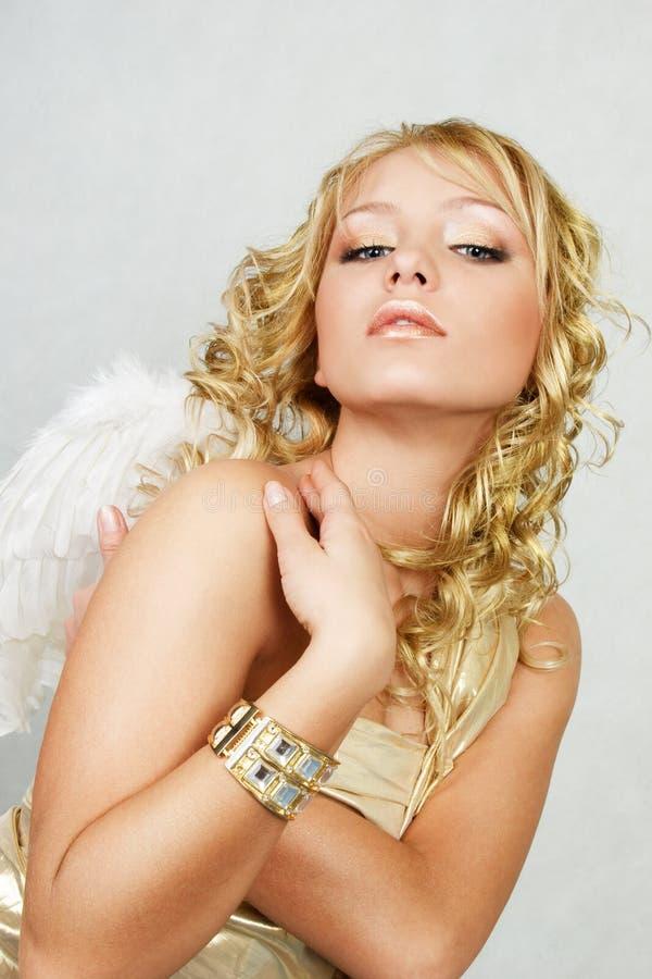 Blonde woman with angel wings. Beautiful blonde woman with angel wings royalty free stock photo