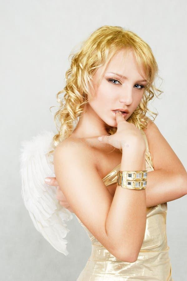 Blonde woman with angel wings. Beautiful blonde woman with angel wings royalty free stock images