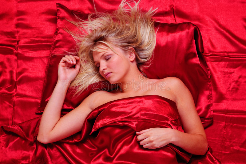 Download Blonde Woman Asleep On Red Satin Sheets Royalty Free Stock Photography - Image: 9241317
