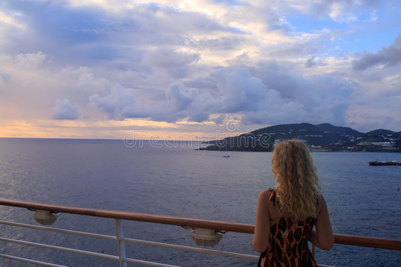 Blonde woman from back and view of St Maarten in Caribbean sea f. Rom cruise ship near Phillisburg stock photography