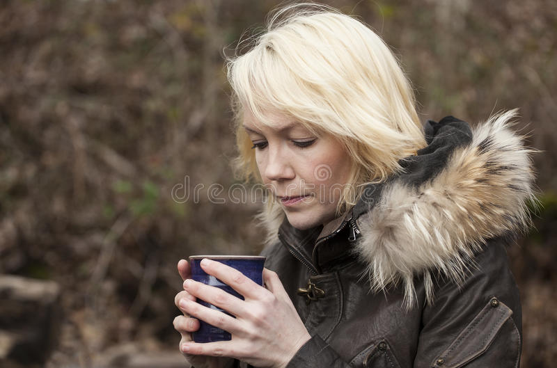 Blonde Woman with Beautiful Blue Eyes royalty free stock photos