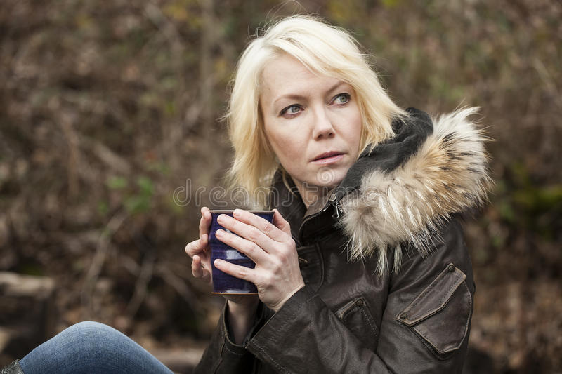 Blonde Woman with Beautiful Blue Eyes stock photos