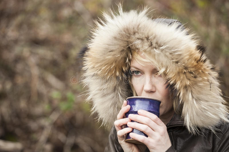 Blonde Woman with Beautiful Blue Eyes Drinking Coffee stock image