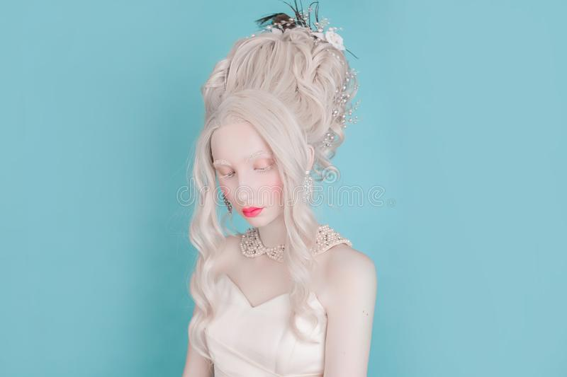 Blonde woman with beautiful luxurious rococo hairstyle royalty free stock images