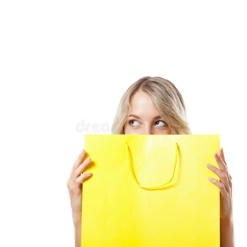Download Blonde Woman Behind Yellow Shopping Bag Royalty Free Stock Image - Image: 25825286