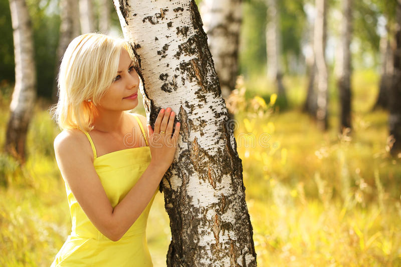 Blonde Woman at Birch Forest. Beautiful Smiling Girl Outdoor stock images