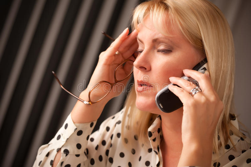 Download Blonde Woman On Cell Phone With Stressed Look Stock Photo - Image: 11833376