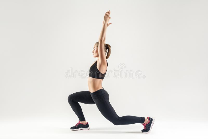 Blonde woman doing pilates. Profile, side view. stock photos