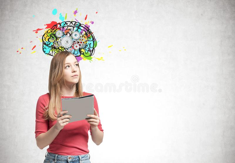Blonde woman with a folder, cog brain royalty free stock photography