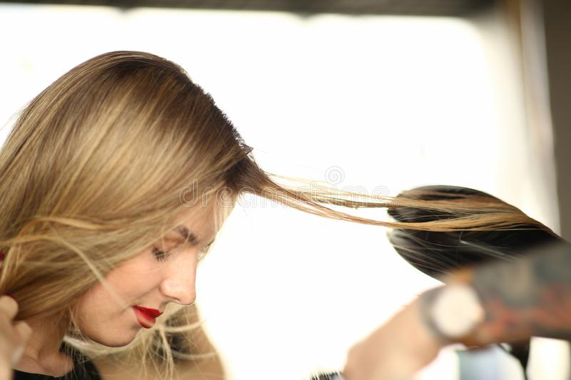 Blonde Woman Getting Hairstyle Closeup Photography stock image