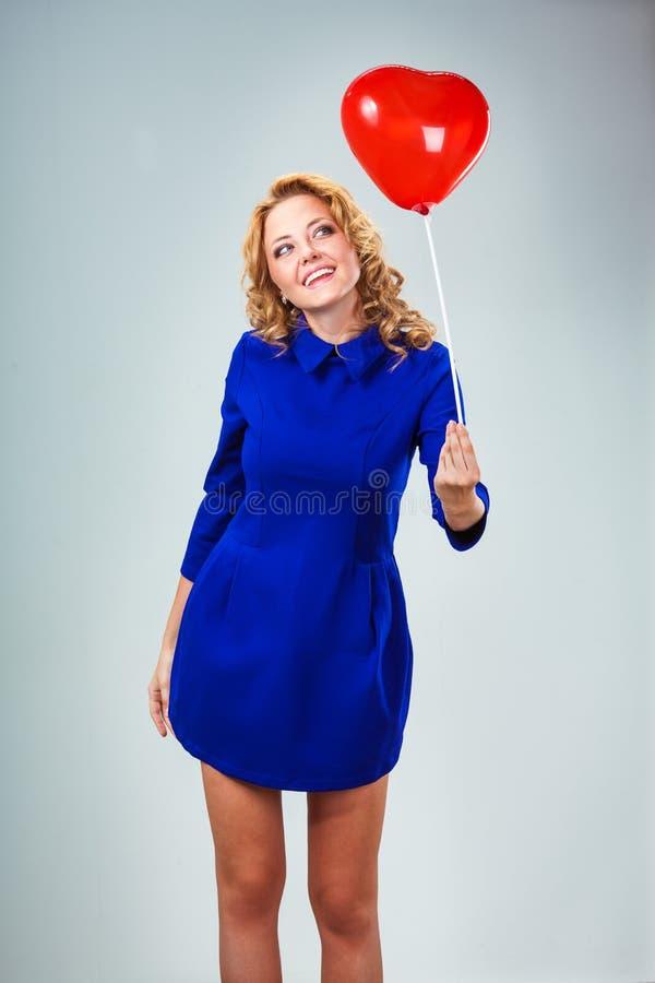 Blonde woman holding ballons royalty free stock photos
