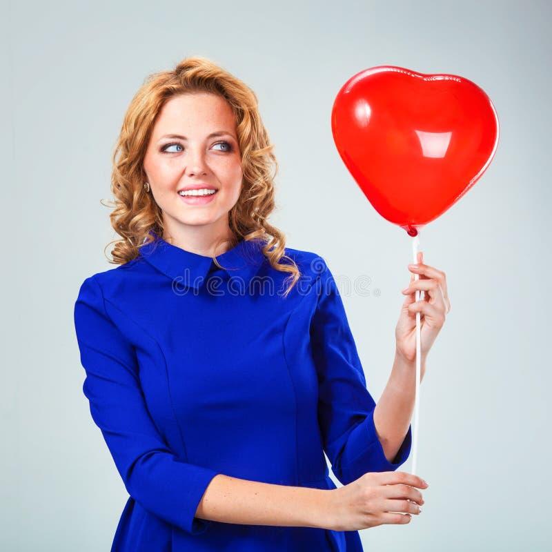 Blonde woman holding ballons stock photo