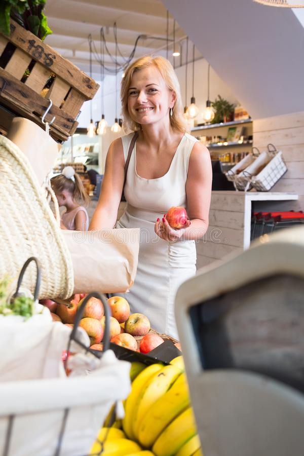 Blonde woman housewife in supermarket stock photography