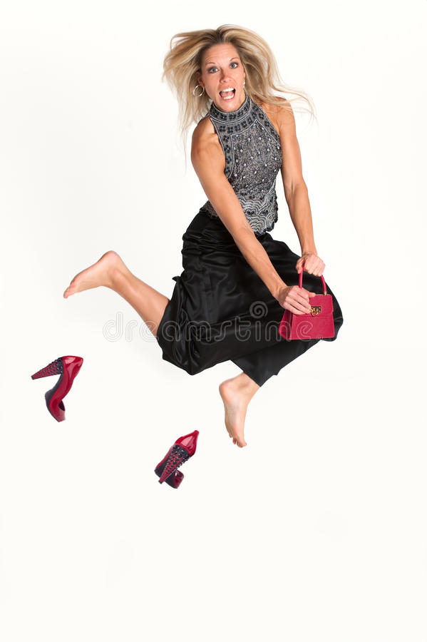 Blonde Woman Jumping royalty free stock images