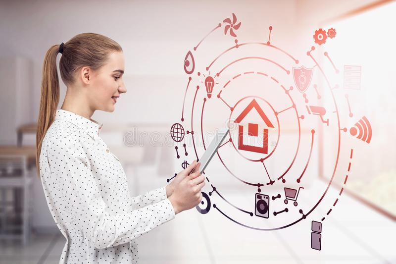 Blonde woman in kitchen, smart home interface royalty free stock images